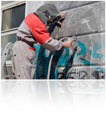 Graffiti Removal - man removing grafitti